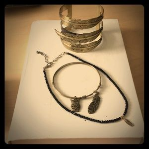 Gold feather jewelry bundle.